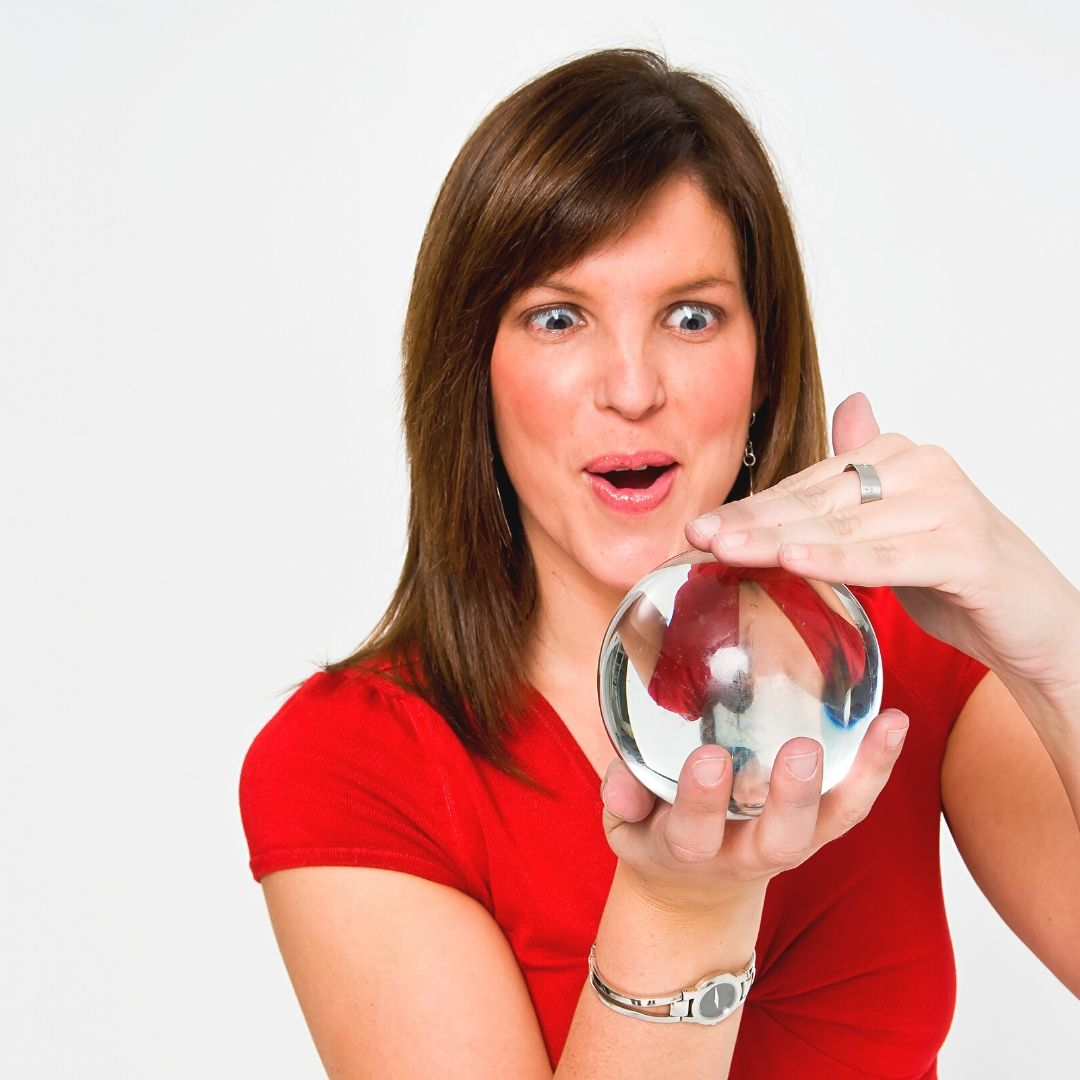 Woman looking into crystal ball