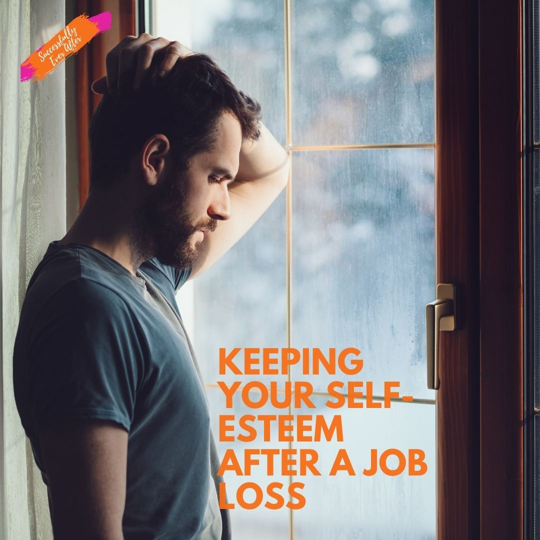 sad man looking out window after job loss