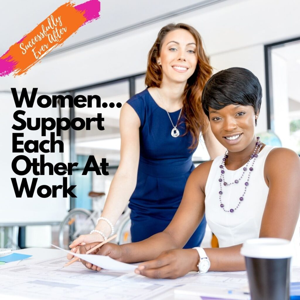 two women in a work environment smiling
