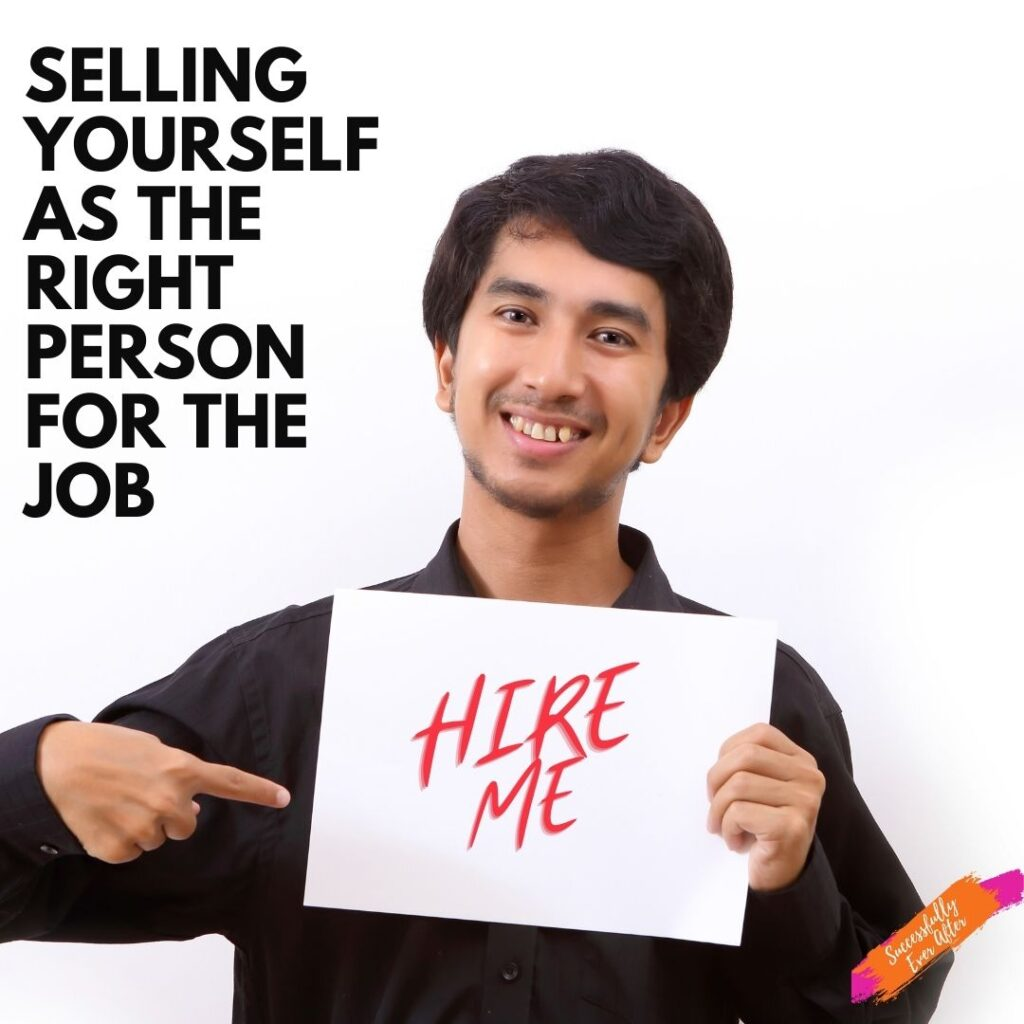 Male holding a sign that reads Hire Me.