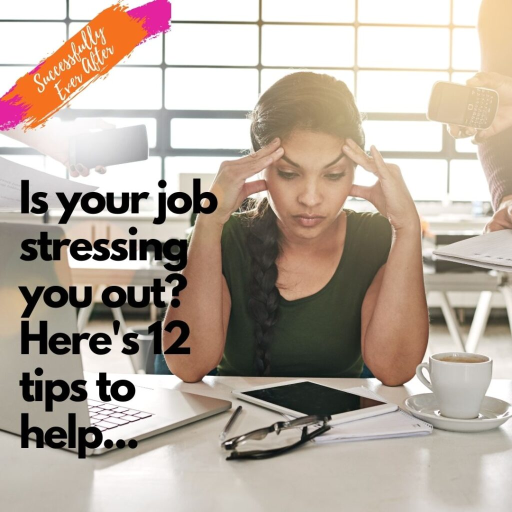 Female with hands on forehead feeling stressed at work
